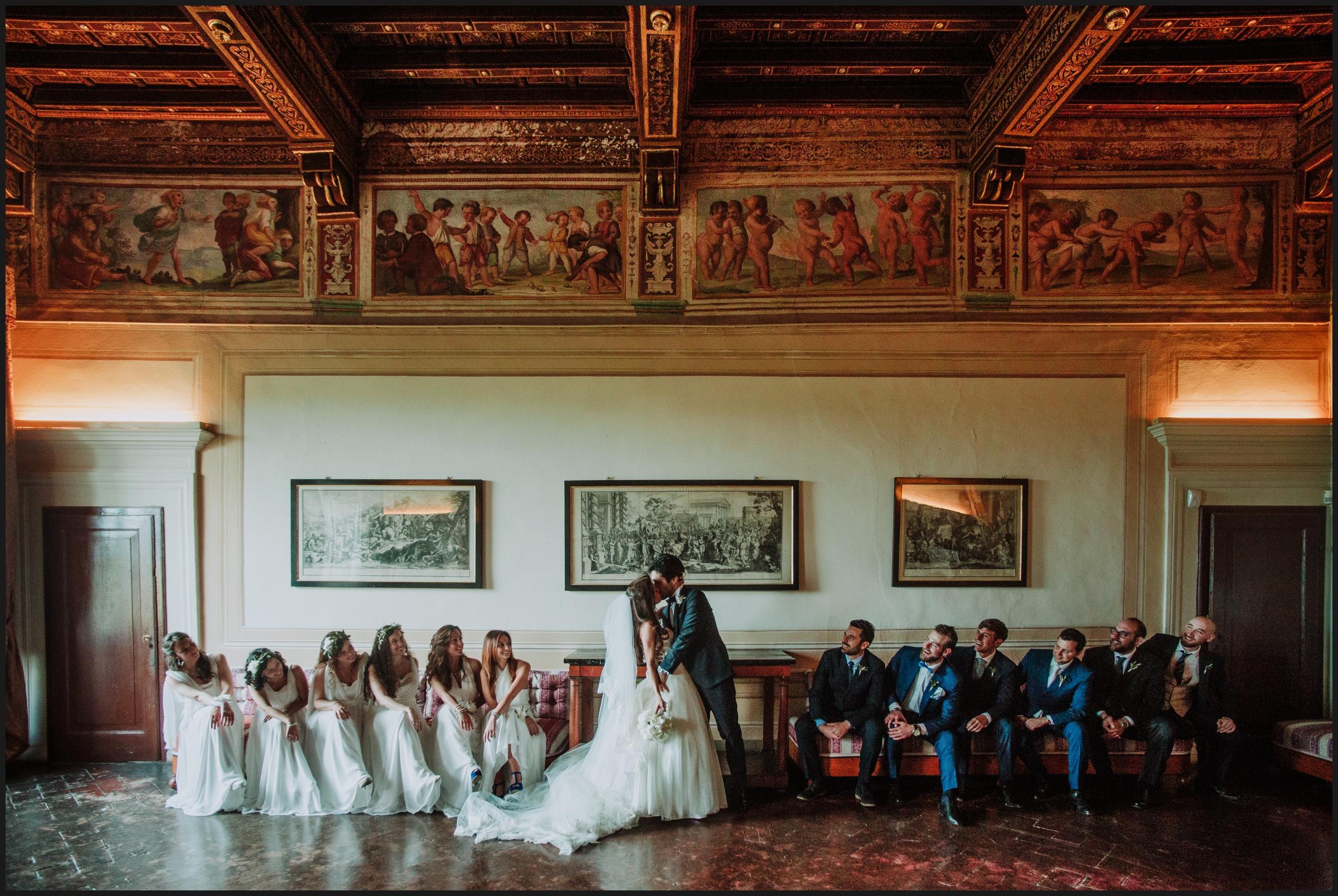 bridesmaids, groomsmen, bride and groom kiss