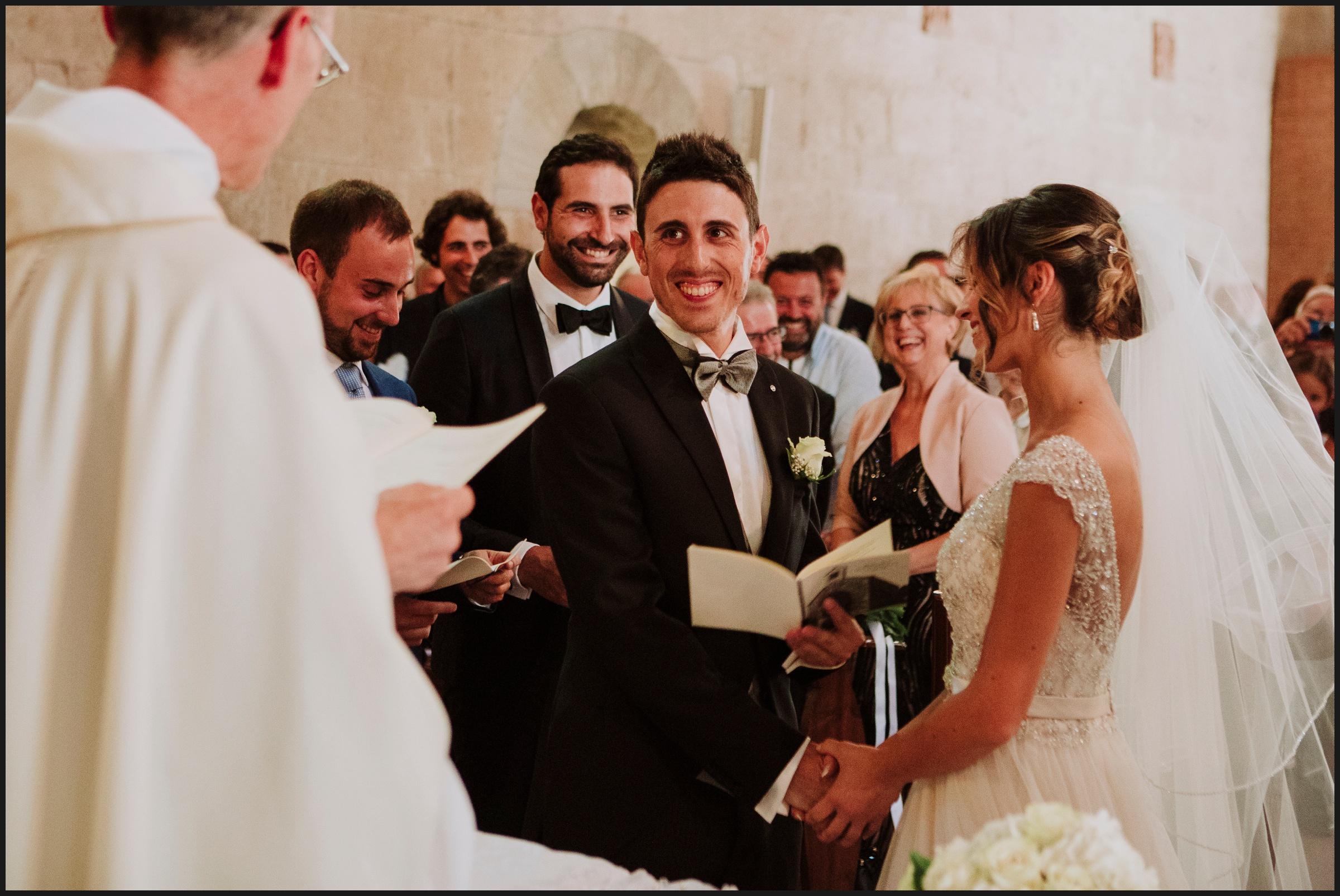 Wedding ceremony, groom smiling